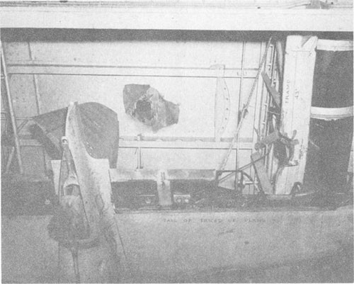 Photo F-5: Second hit. View from hangar deck showing bomb entry hole in flight deck and point of impact on transverse bent at frame 43.