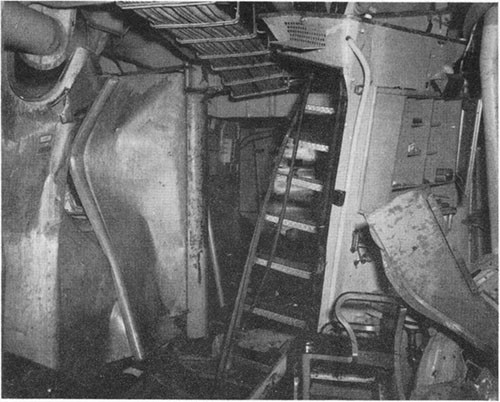 Photo F-9: Second hit. Blast effect in A-306-L, starboard side looking aft. Stanchion in center is at frame 50.