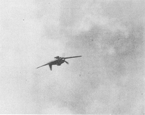 Photo J-1: Japanese suicide plane (ZEKE-52) just before striking deck.