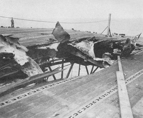 Photo J-3: Hole in flight deck at frame 42, made by crashing suicide plane.