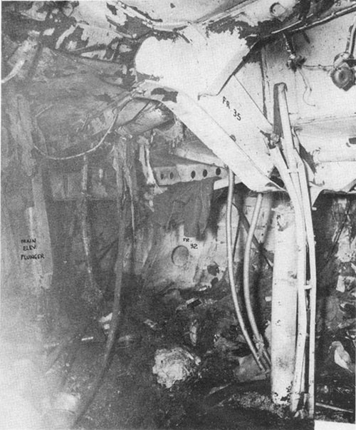 Photo J-4: View of destruction in A-305-A where bomb carried by suicide plane detonated.
