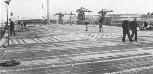 Photo J-8: View of flight deck looking forward from frame 75 showing deformation of deck.