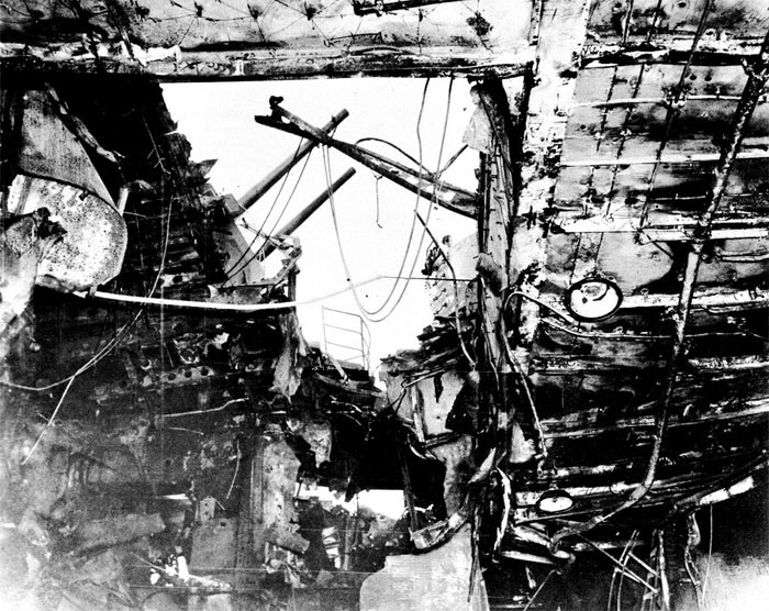 Photo 3: 30 October Action. View taken from hangar looking to starboard and up. Note damage to bomb elevator trunk and sprinkler equipment.