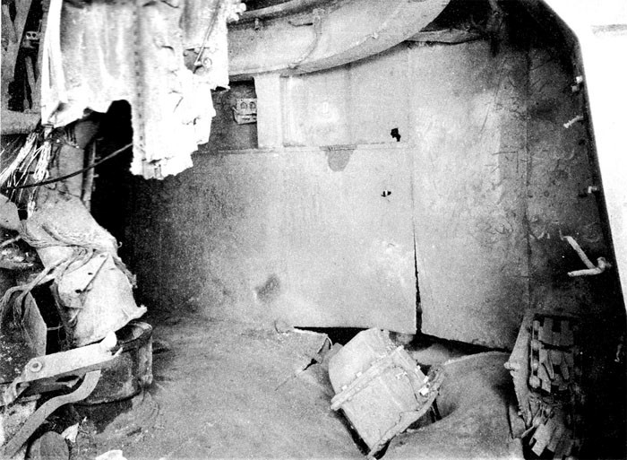 Photo 41. 19 March Action. Upper handling room No. 7 5-inch twin mount. Looking aft port side. Note damage to after port hoist.
