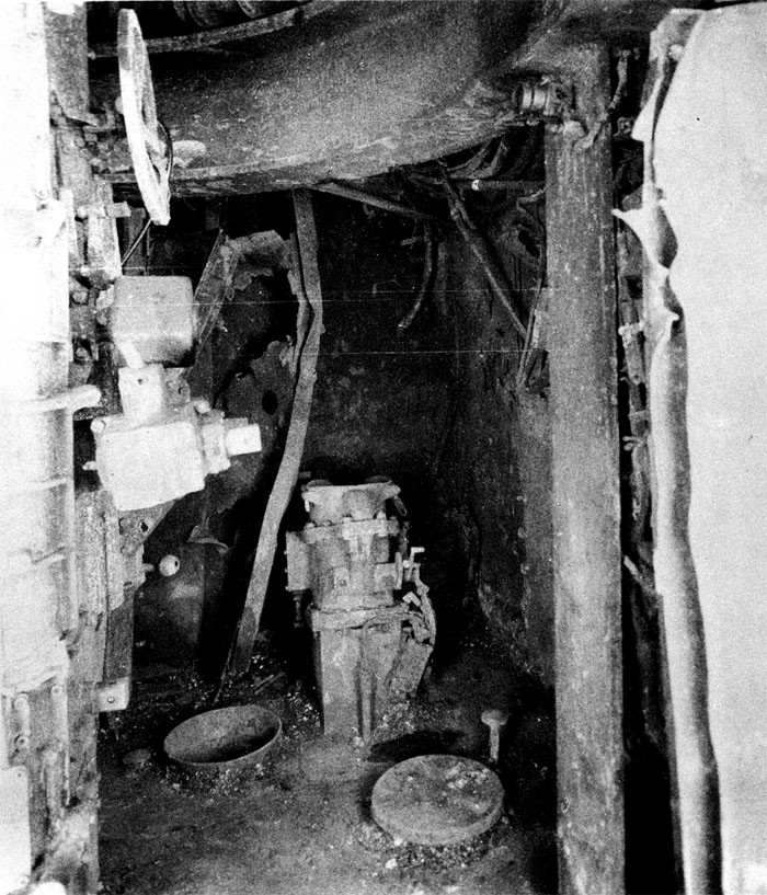 Photo 39: 19 March Action. Upper handling room No. 7 5-inch twin mount, starboard side looking forward. Forward starboard hoist is intact.