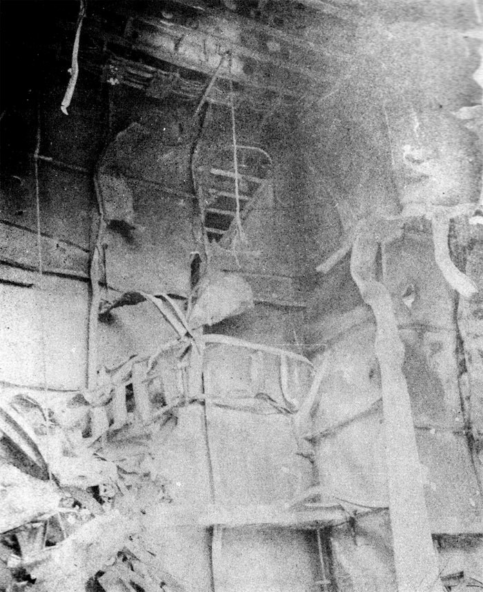 Photo 34: 19 March Action. View of demolished ladder in hangar.