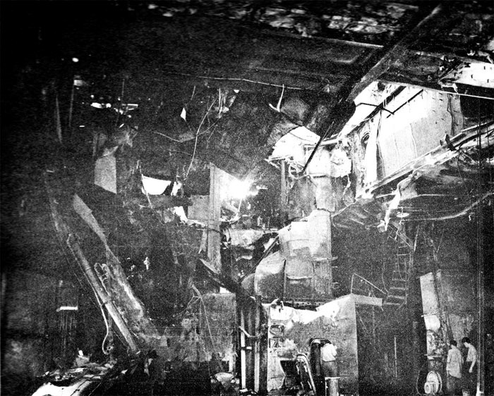 Photo 5: 30 October Action. View taken from hangar looking to starboard. Note damage to air intake ducts; bomb elevator trunk; ladder.