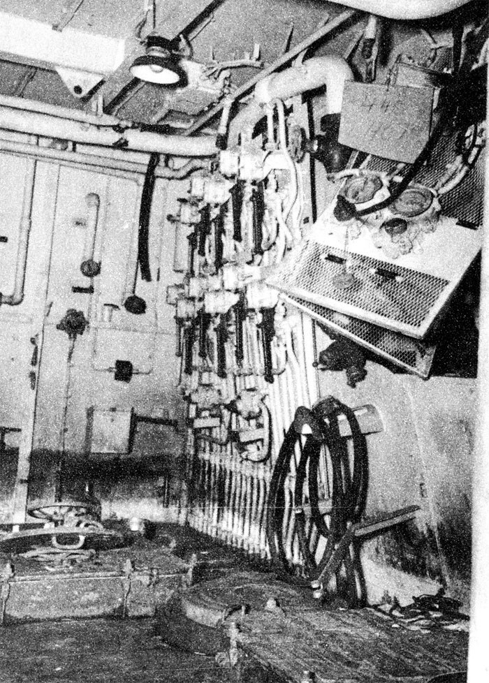 Photo 7: 30 October Action. View showing distortion of uptake enclosure bulkhead on which hydraulic valve controls are mounted, frame 112, compartment B-313-E. Hydraulic controls remained operable.