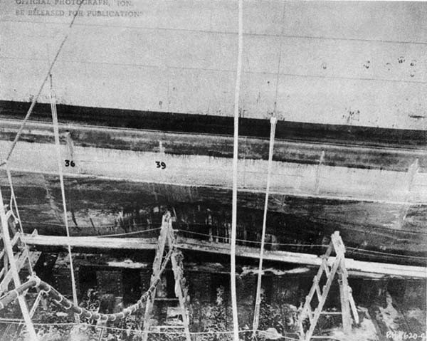 Photo No. 5: General view of damage, showing holes cut to admit Wheeler System cleaning hose.