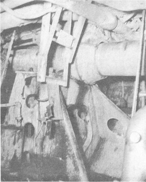 Photo No. 11: Spring bearing for No. 1 shaft in after fireroom. The distortion of starboard shell plating in vicinity of frame 83 forced the bearing and shaft upward.