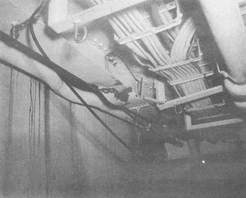 Photo No. 12: Buckling of No. 3 port longitudinal, under main deck, in compartment B-203-2L.