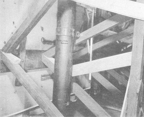 Photo No. 15: Shoring in C-313-L on forward side of bulkhead 136. Note the use of side cleaning planks and fueling booms.