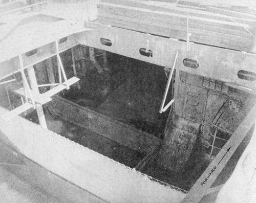 Photo No. 20: Temporary transverse and longitudinal bulkheads installed in the hangar space by the ship's force at Ulithi.