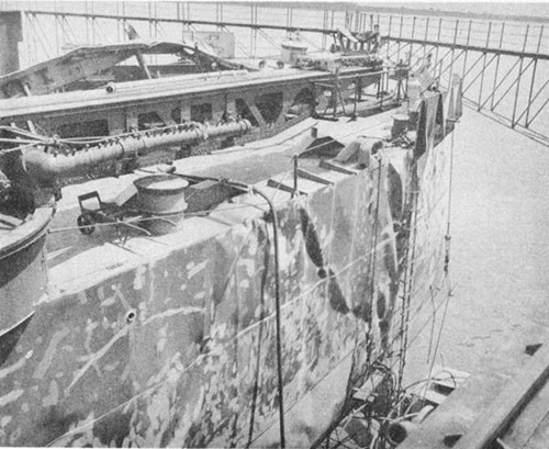 Photo No. 21: Wrinkling of port main deck and shell plating at the stern.