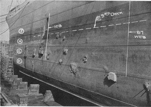 Photo 1: USS ELECTRA - port side looking forward and showing the small patches over fragment holes.