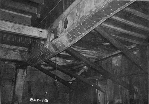Photo 4: USS ELECTRA - looking forward and to starboard at the shoring for the large patch. Fragment damage to the third deck in way of the hit is also visible.