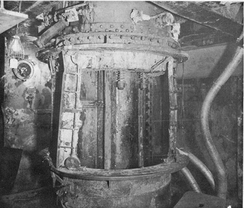 "Photo 11: USS NEW ORLEANS - Damage to flame-proof doors of 8"" powder hoist, lower handling room of turret II."
