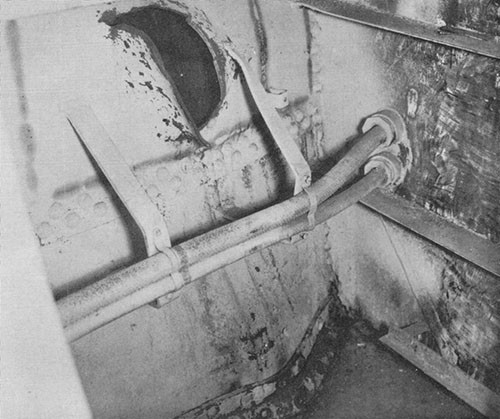 Photo 15: USS NEW ORLEANS - Hole in port shell at frame 136, caused by bow striking port quarter as it drifted aft.