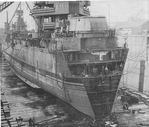 Photo 18: USS NEW ORLEANS - In dry dock at Navy Yard Puget Sound, 10 April,. 1943. Stub bow partially removed.