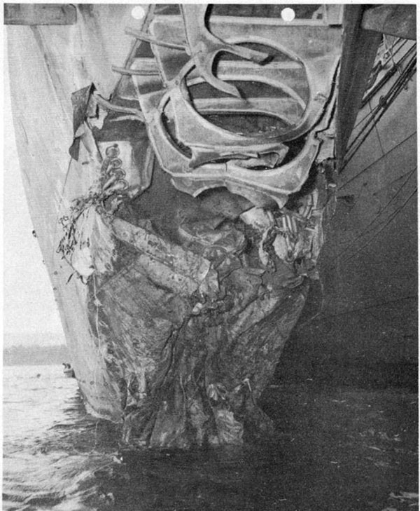 Photo 3: Damage to bow resulting from torpedo hit. Alongside U.S.S. CURTISS, 17 September, 1942.