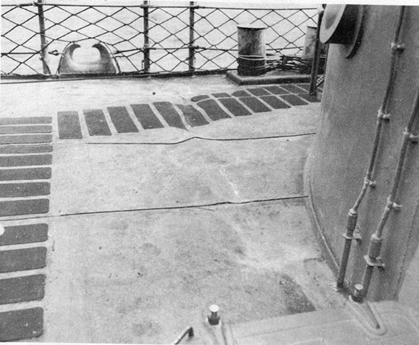 Photo 5: Wrinkles, starboard side, forecastle deck frame 37 caused by flexural vibration of the vessel as a result of the shock of the torpedo detonation.