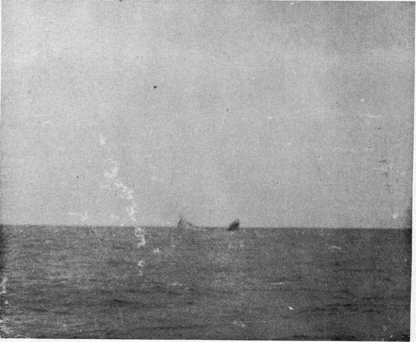 Photo 7: At 0750, 19 October, 1942. Heavy list to starboard. Breaking up process well advanced.