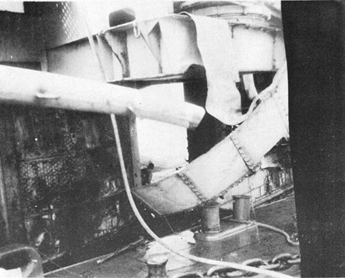 Hole blown in hangar deck at about frame 114. Gun sponson was damaged by ships alongside.