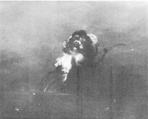 Explosion of forward bomb magazines initiated by torpedo hits. PRINCETON had sunk by the time smoke cleared.