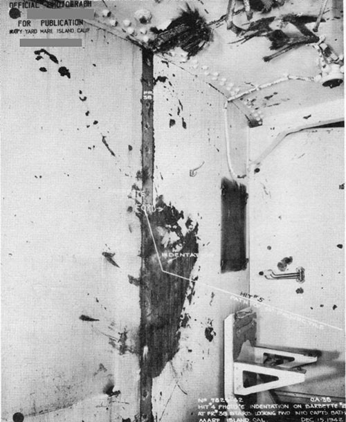 "Photo 11: Turret II barbette at point where 14"" shell (Hit No. 5) struck it showing approximate path of projectile."