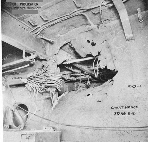 "Photo 20: Hit No. 12 (5-1/2"") looking inboard at the starboard bulkhead of the chart house and showing damage to the circulating water cooler for the starboard 1.1 mount."