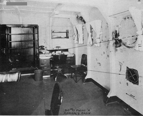 "Photo 25: Admiral's cabin looking aft and showing path of Hit Ho. 21 (5"")."