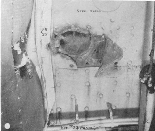 "Photo 28: Hit No. 24 (6"") showing hole through two thicknesses of 35 lb. S.T.S."