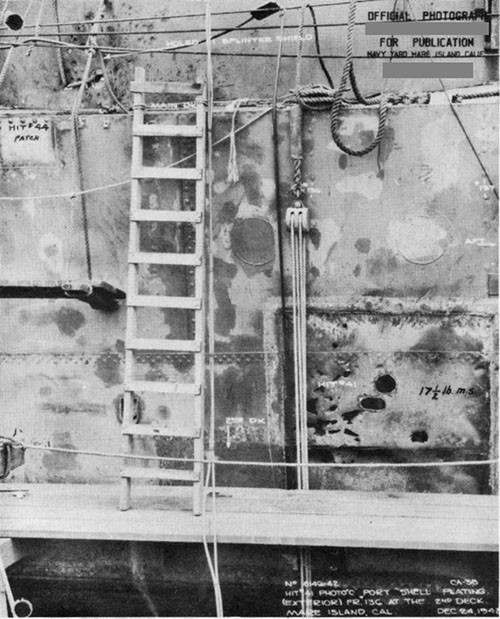 "Photo 43: Hit No. 45 (8"") looking at port shell plating. This hit (probably a ricochet) exploded just before hitting the ship."