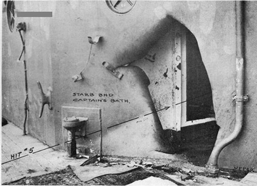 "Photo 10; Hit No. 5 showing point of entry of 14"" shell into Captain's bath."