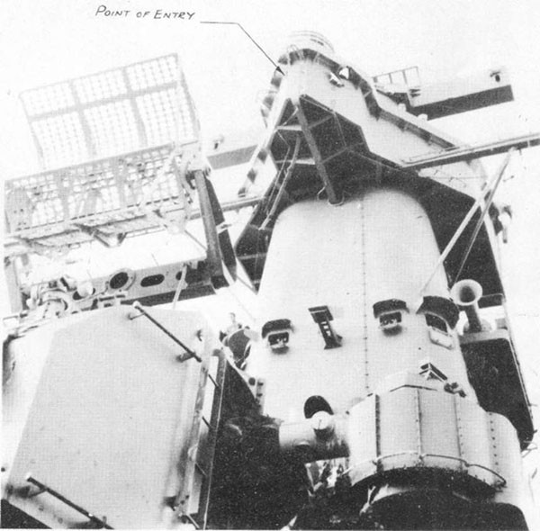 Photo 12: Exit holes of hit No. 9 on port side of wind and spray shield around air defense forward. Entry hole on starboard side of spray shield can also be seen.