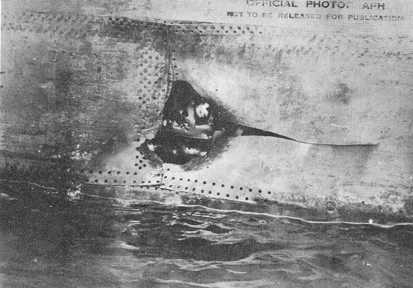 Photo 16: Hit No. 11 on starboard shell. Note fragment holes in torpedo bulkhead No. 2.