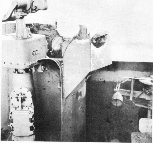 Photo 20: Hit No. 12 showing damage to wind and spray shield around port target designator.