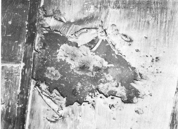 Photo 30: Hit No. 22. Damage to port structural bulkhead in battle dressing room.