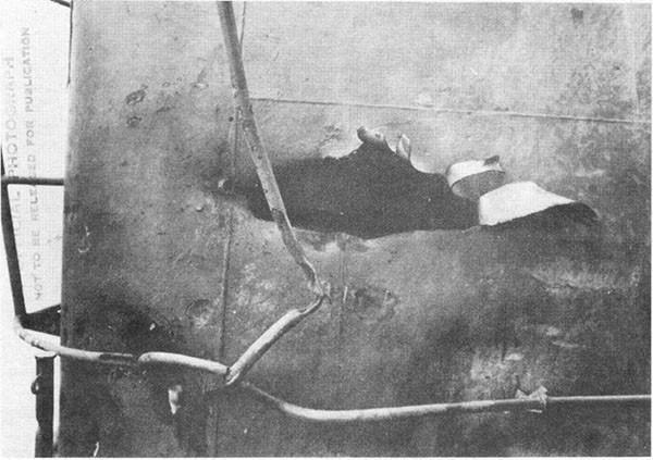 Photo 31: Hit No. 23. Damage to starboard side of stack hood.