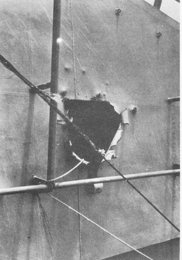Photo 32: Hit No. 23. Damage to port side of stack hood.