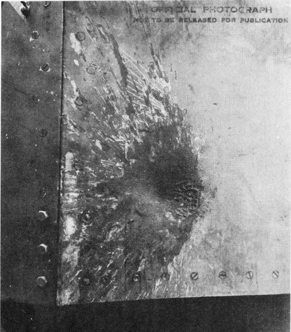Photo 33: Hit No. 24. Damage to 5-inch mount No. 5 from glancing hit by 6-inch projectile.