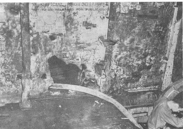 Photo 37: Hit No. 26. Damage to bulkhead 129 above second deck.