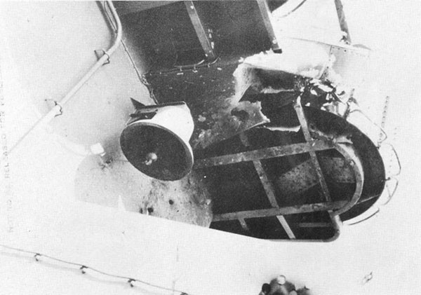 Photo 38: Damage to bulkhead 81 and radio direction finder foundation possibly from detonation of hit No. 7.
