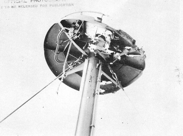 Photo 39: Damage to radar platform apparently from a projectile that detonated on contact.