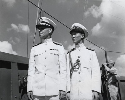Rear Admiral Milton E. Miles, USN on board USS Rocy Mount (AGC-3), in Chinese waters, circa September-October 1945. He is with an officer of the Chinese Navy.