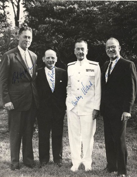 L-R VADM Edwin B. Hooper, Adm. Horacio Rivero, Jr., Adm. Alfred G. Ward and VADM. Lloyd M. Mustin, Photographed circa 1970-71. They were called the 'Four Horsemen' at MIT, where all received Masters Degrees (SM) in Electrical Engineering. As Lieutenants, these four officers started the Ordnance Post graduate Course in fire control. All have signed this photograph.Courtesy of Vice Admiral Edwin B. Hooper, USN, 1972. Naval History & Heritage Command, Photographic Section. #NH76155.
