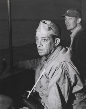 Rear Admiral Clifton A. F. Sprague, US Navy, aboard USSFanshaw By (CVE-70) off Okinawa in April 1945. Photographic Section, Naval History and Heritage Command, #80-G-371327.