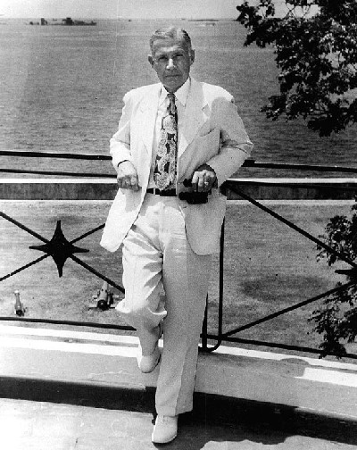 Admiral Raymond A. Spruance, USN (Retired). On the balcony of the U.S. Embassy, Manila, while serving as U.S. Ambassador to the Philippines in 1952-55. Several Japanese ships, sunk in Manila Bay during World War II, are visible in the background. Naval Historical Center Photographic Section: #: NH 44860.