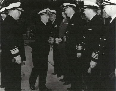 Admiral Royal E. Ingersoll, ComWESTERN SEA FRONTIER, greets senior officers while inspecting the Mare Island Navy Yard, 15 March 1945. Rear Admiral Tisdale, Comdt of Mare Island Navy Yard is at left. In the receiving line are (l-r): Capt. W.C. Espach (MC), Col. J.E. Betts, USMC, Capt. G.C. Klein, Capt. A.O. Gieselman, and Capt. F.C. Bedell.