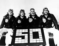 Fighter Squadron Nine (VF-9) Aces. Pose with a sign signifying their fifty victories over Japanese aircraft. Probably taken on board USS Yorktown (CV-10) at the end of the squadron's combat zone tour, circa Spring 1945.Aviators shown are (left to right):Lieutenant Harris E. Mitchell, USN,(10 Victories)Lieutenant Junior Grade Clinton L. Smith, USN,(6 Victories)Lieutenant James B. French, USN,(11 Victories)Lieutenant Eugene A. Valencia, USN,(23 Victories)Note VF-9 Insignia on their flight jackets. NHHC Photo #: 80-G-700016